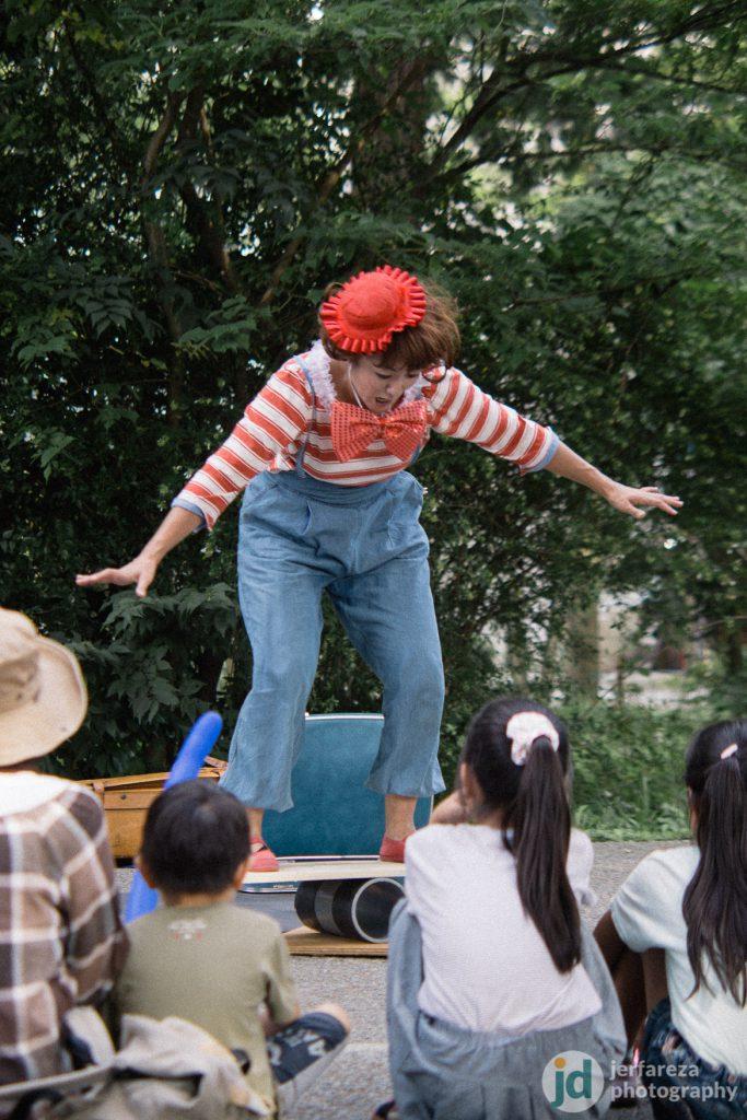 A street performer balancing act…